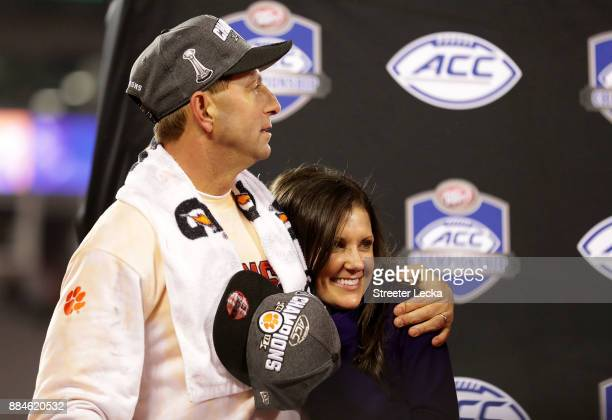 Head coach Dabo Swinney of the Clemson Tigers hugs his wife Kathleen Bassett during the trophy ceremony at the ACC Football Championship at Bank of...