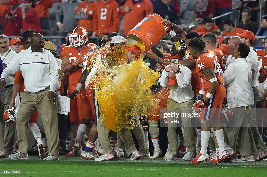 Head coach Dabo Swinney of the Clemson Tigers is doused with Gatorade during the second half of the 2016 PlayStation Fiesta Bowl against the Ohio State Buckeyes at University of Phoenix Stadium on December 31, 2016 in Glendale, Arizona.