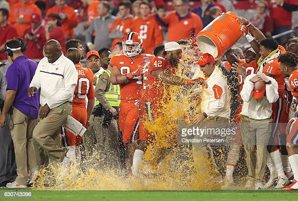 Head coach Dabo Swinney of the Clemson Tigers is dunked with Gatorade during the fourth quarter of the 2016 PlayStation Fiesta Bowl against the Ohio...