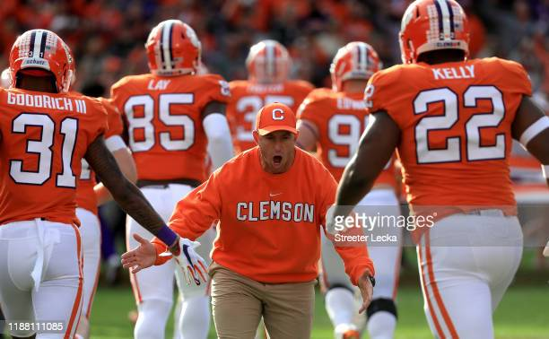 Head coach Dabo Swinney of the Clemson Tigers reacts with players before their game against the Wake Forest Demon Deacons at Memorial Stadium on...