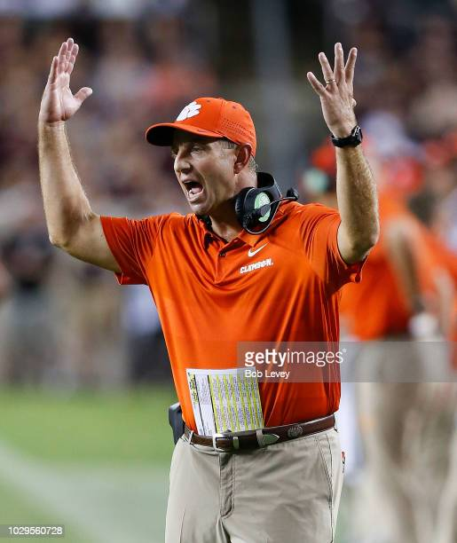 Head coach Dabo Swinney of the Clemson Tigers shows his displeasure with the officials call in the fourth quarter against the Texas AM Aggies at Kyle...