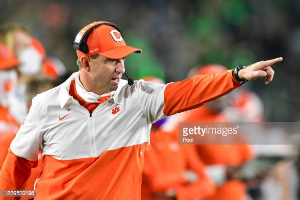Head coach Dabo Swinney of the Clemson Tigers signals to his players in the second quarter against the Notre Dame Fighting Irish at Notre Dame...
