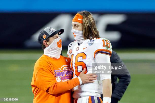 Head coach Dabo Swinney of the Clemson Tigers stands with quarterback Trevor Lawrence after defeating the Notre Dame Fighting Irish 34-10 in the ACC...