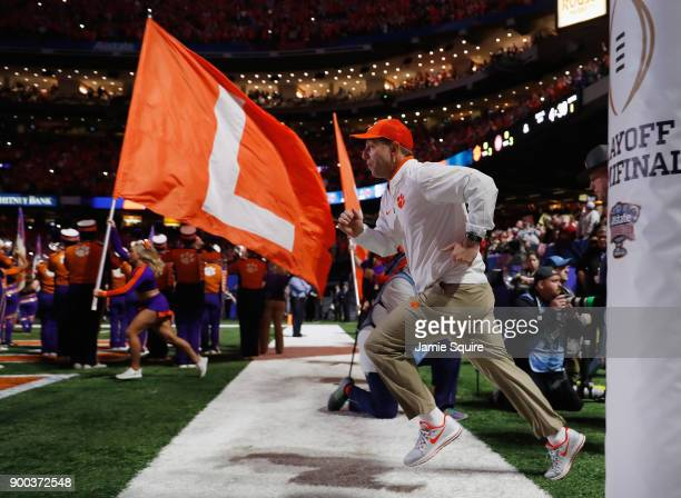 Head coach Dabo Swinney of the Clemson Tigers takes the field prior to the AllState Sugar Bowl against the Alabama Crimson Tide at the MercedesBenz...