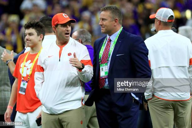 Head coach Dabo Swinney of the Clemson Tigers talks with ESPN's Kirk Herbstreit on the field prior to the College Football Playoff National...