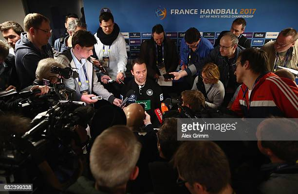 Head coach Dagur Sigurdsson of Germany is surrounded by journalists during the press conference after the 25th IHF Men's World Championship 2017...