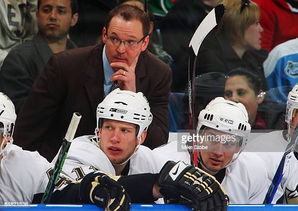 Head coach Dan Bylsma of the Pittsburgh Penguins looks on during the game against the New York Islanders at Nassau Coliseum February 16, 2009 in...