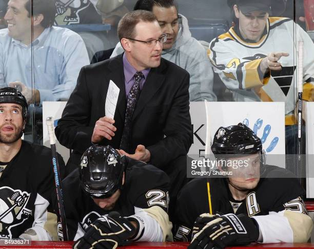 Head coach Dan Bylsma of the Pittsburgh Penguins looks on during the game against the Montreal Canadiens at Mellon Arena February 19 2009 in...