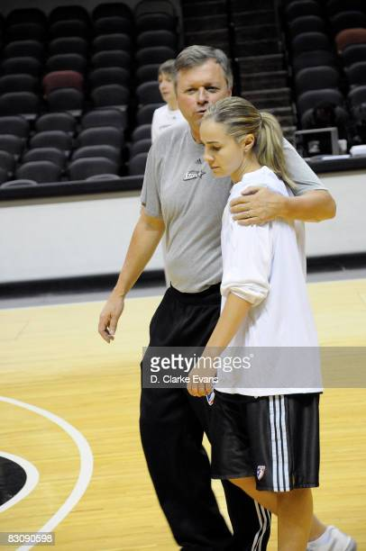 Head Coach Dan Hughes speaks to Becky Hammon of the San Antonio Silver Stars during media availability after Game One of the WNBA Finals on October 2...