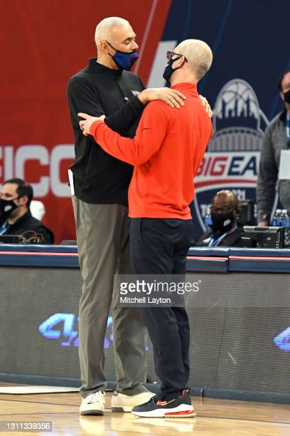 Head coach Dan Hurley of the Connecticut Huskies and head coach Dave Leitao of the DePaul Blue Demons talk after the Big East Men's Basketball...