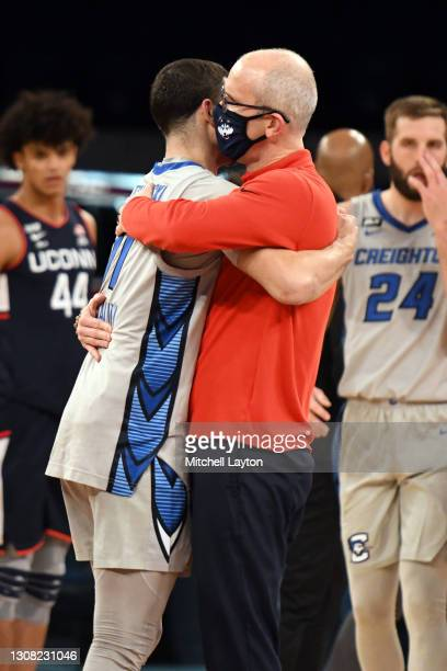 Head coach Dan Hurley of the Connecticut Huskies and Marcus Zegarowski of the Creighton Bluejays hug after the Big East Men's Basketball Tournament -...