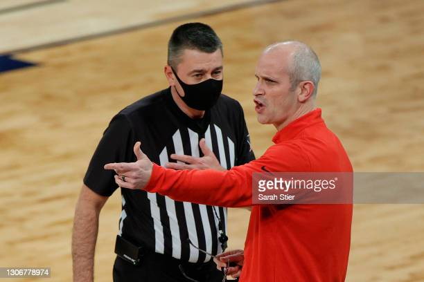 Head coach Dan Hurley of the Connecticut Huskies argues with the referee in the first half against the Creighton Bluejays during the Semifinals of...