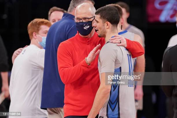 Head coach Dan Hurley of the Connecticut Huskies congratulates Marcus Zegarowski of the Creighton Bluejays after the semifinal game in the Big East...