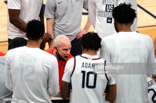 Head coach Dan Hurley of the Connecticut Huskies directs his team during a timeout in the first half against the DePaul Blue Demons during the...