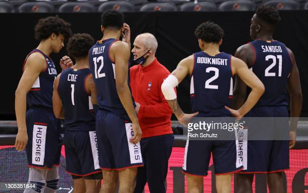 Head coach Dan Hurley of the Connecticut Huskies huddles with his team during an NCAA college basketball game against the Seton Hall Pirates at...