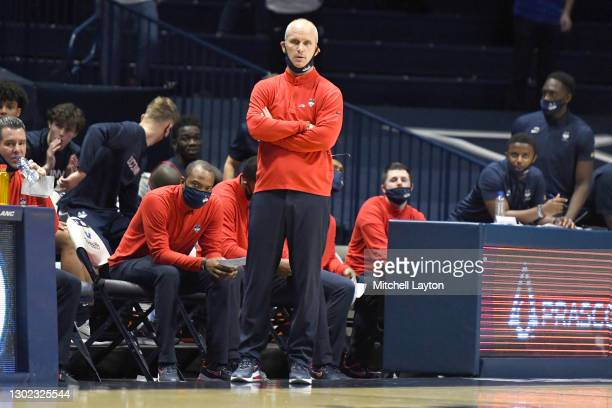 Head coach Dan Hurley of the Connecticut Huskies looks on during a college basketball game against the Xavier Musketeers at Cintas Center on February...