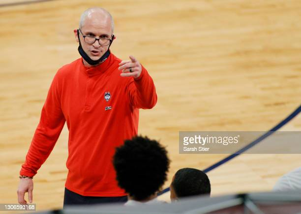 Head coach Dan Hurley of the Connecticut Huskies points at his bench in the first half against the DePaul Blue Demons during the Quarterfinals of the...