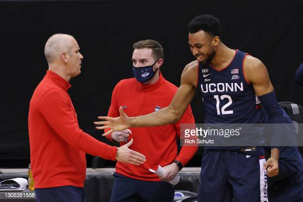Head coach Dan Hurley of the Connecticut Huskies shakes hands with Tyler Polley during an NCAA college basketball game against the Seton Hall Pirates...