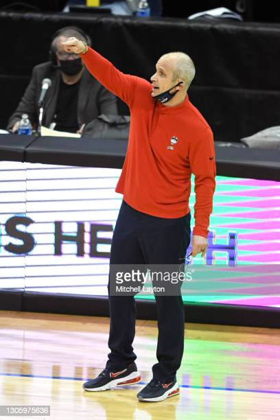 Head coach Dan Hurley of the Connecticut Huskies signals to his players during a college basketball game against the Seton Hall Pirates at the...