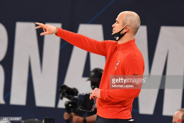 Head coach Dan Hurley of the Connecticut Huskies signals to his players during the Big East Men's Basketball Tournament - Quarterfinals college...