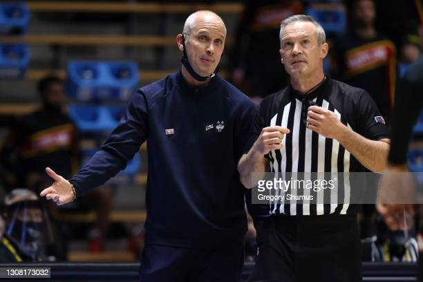 Head coach Dan Hurley of the Connecticut Huskies speaks with an official during the second half against the Maryland Terrapins in the first round...