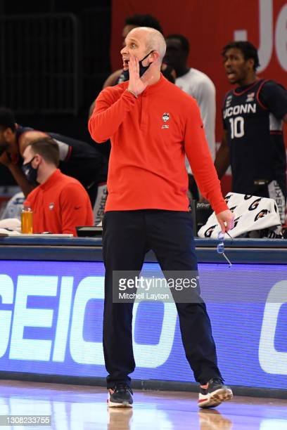 Head coach Dan Hurley of the Connecticut Huskies talks to his players during the Big East Men's Basketball Tournament - Semifinals college basketball...
