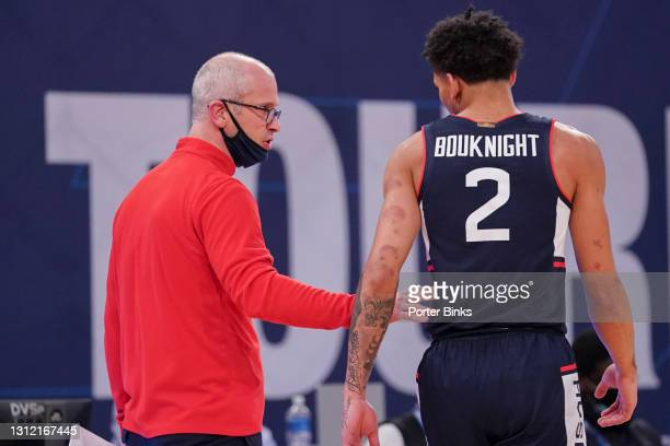 Head coach Dan Hurley of the Connecticut Huskies talks with James Bouknight during the semifinal game against the Creighton Bluejays in the Big East...