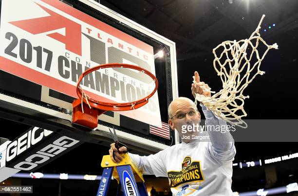 Head coach Dan Hurley of the Rhode Island Rams cuts down the net after defeating the Virginia Commonwealth Rams 7063 during the championship game of...