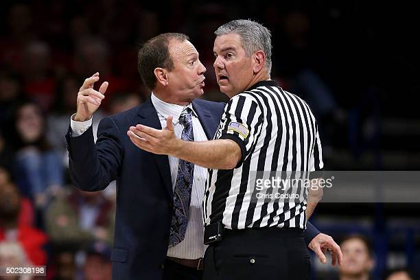 Head coach Dan Monson of the Long Beach State 49ers gestures at official Bill Vinovich during the second half of the college basketball game at...