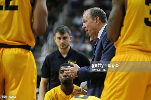 Head coach Dan Monson of the Long Beach State 49ers talks to his team during a timeout against the Michigan State Spartans at Breslin Center on...