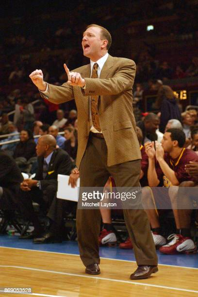 Head coach Dan Monson of the Minnesota Gophers yells to his players during a SemiFinal NIT college basketball game against the Georgetown Hoyas at...