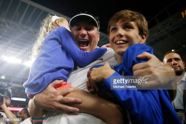 Head coach Dan Mullen of the Florida Gators celebrates with his kids, Breelyn and Canon, after defeating the Virginia Cavaliers 36-28 in the Capital...