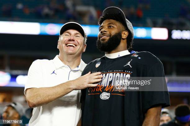 Head coach Dan Mullen of the Florida Gators celebrates with Lamical Perine after defeating the Virginia Cavaliers 36-28 in the Capital One Orange...