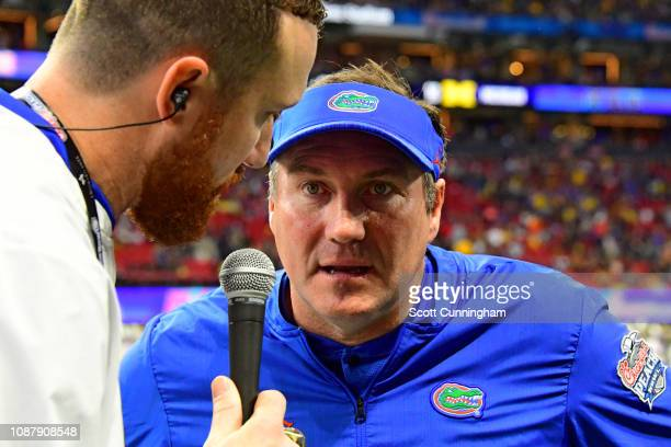 Head coach Dan Mullen of the Florida Gators is interviewed after the first half during the game against the Michigan Wolverines during the ChickfilA...