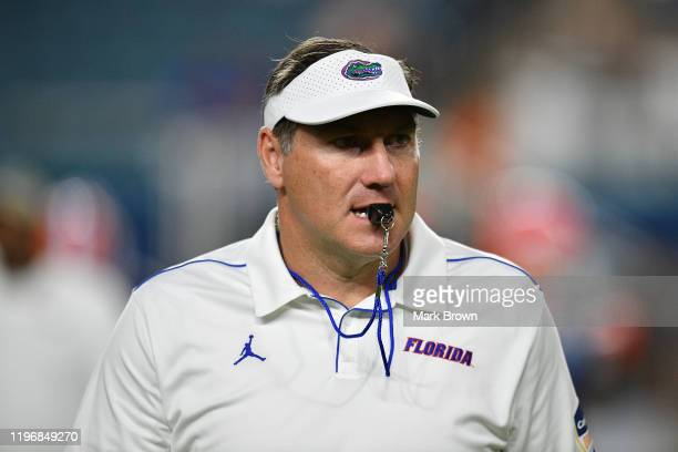 Head Coach Dan Mullen of the Florida Gators on the field during warm ups prior to the Capital One Orange Bowl against the Virginia Cavaliers at Hard...