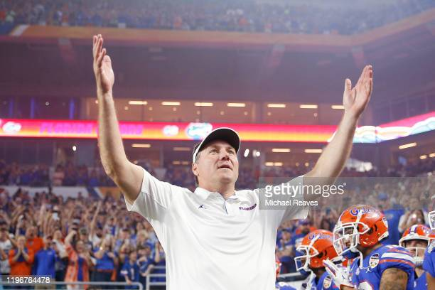 Head coach Dan Mullen of the Florida Gators pumps up the crowd prior to the start of the Capital One Orange Bowl against the Virginia Cavaliers at...