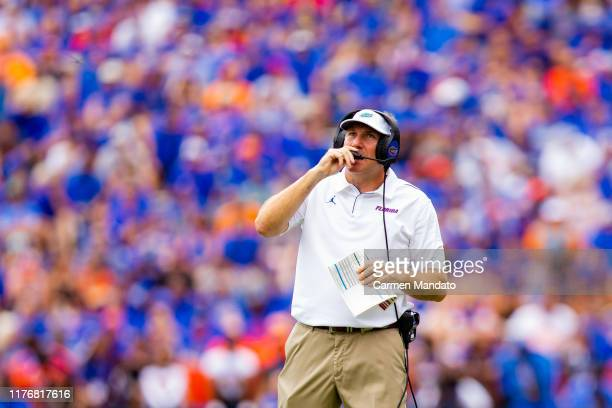 Head coach Dan Mullen of the Florida Gators speaks into his headset during the game against the Tennessee Volunteers at Ben Hill Griffin Stadium on...