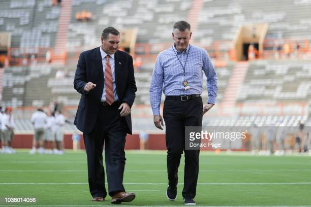 Head coach Dan Mullen of the Florida Gators walks with Florida Athletic Director Scott Stricklin before the game between the Florida Gators and...