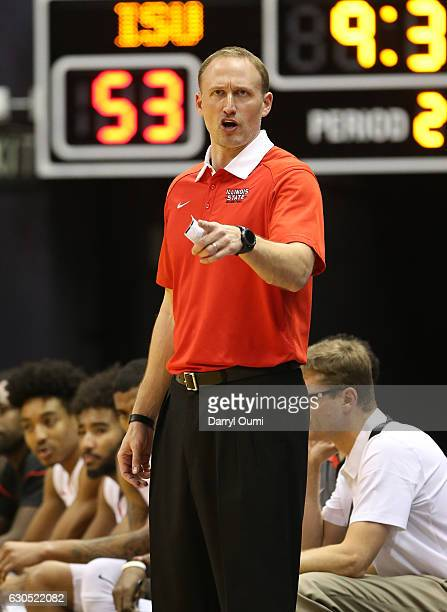 Head coach Dan Muller of the Illinois State Redbirds gestures to his players during the second half of the Diamond Head Classic third place game...