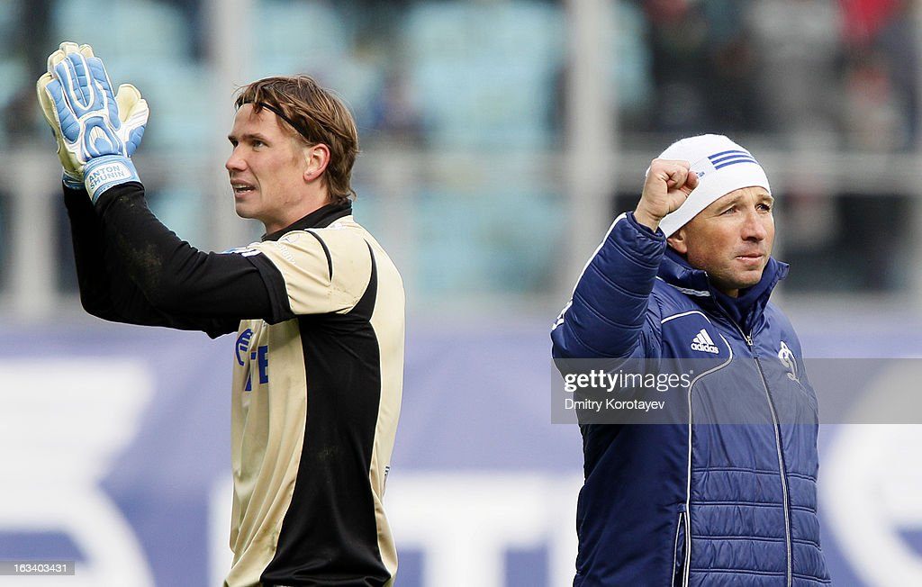 Head coach Dan Petrescu of FC Dynamo Moscow celebrates with Anton Shunin after winning Russian Premier League match between FC Dynamo Moscow and FC Lokomotiv Moscow at the Arena Khimki Stadium on March 09, 2013 in Khimki, Russia.