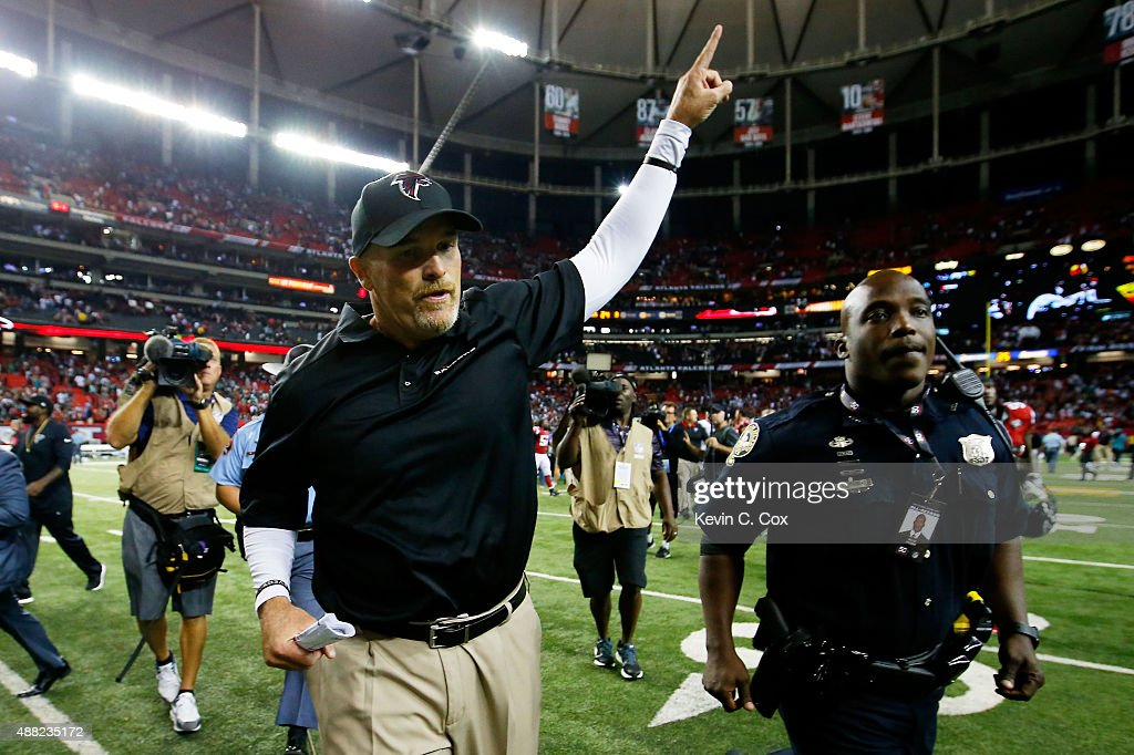 Head coach Dan Quinn of the Atlanta Falcons celebrates beating the Philadelphia Eagles at the Georgia Dome on September 14, 2015 in Atlanta, Georgia.