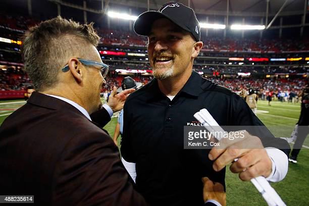 Head coach Dan Quinn of the Atlanta Falcons celebrates with general manager Thomas Dimitroff after beating the Philadelphia Eagles at the Georgia...