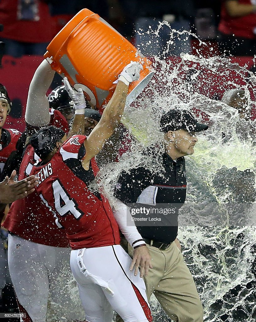 Head coach Dan Quinn of the Atlanta Falcons has gatorade dumped on him by his team late in the game against the Green Bay Packers in the NFC Championship Game at the Georgia Dome on January 22, 2017 in Atlanta, Georgia.