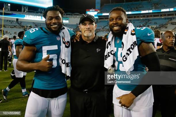 head coach Dan Quinn of the Atlanta Falcons poses with Lerentee McCray and Dante Fowler of the Jacksonville Jaguars during a preseason game at TIAA...