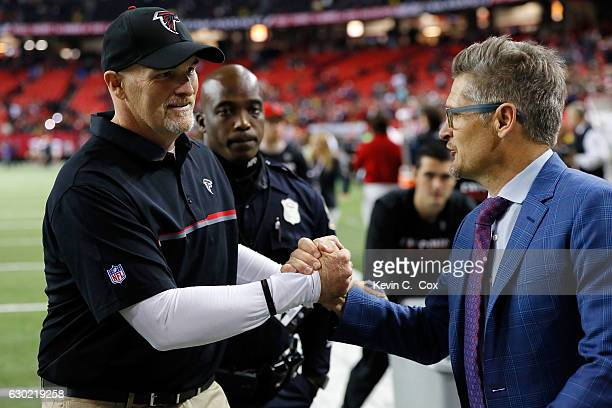 Head coach Dan Quinn of the Atlanta Falcons shakes hands with general manager Thomas Dimitroff after beating the San Francisco 49ers at the Georgia...