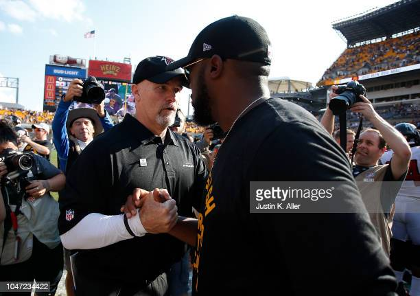 Head coach Dan Quinn of the Atlanta Falcons shakes hands with head coach Mike Tomlin of the Pittsburgh Steelers at the end of a Steelers 4117 win...