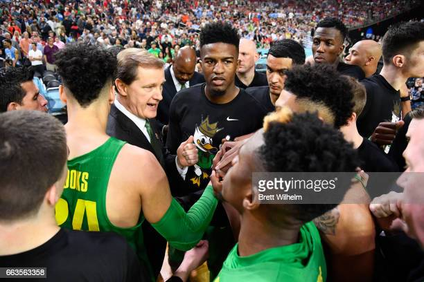 head coach Dana Altman of the Oregon Ducks and team huddle up before tipoff against the North Carolina Tar Heels during the 2017 NCAA Men's Final...