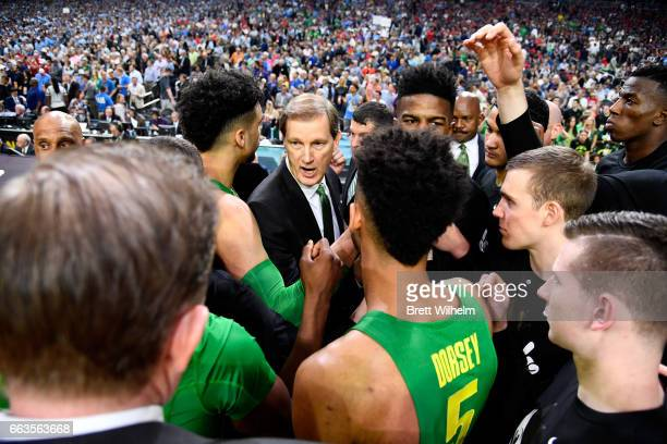 head coach Dana Altman of the Oregon Ducks and team members huddle up prior to tipoff during the 2017 NCAA Men's Final Four Semifinal against the...