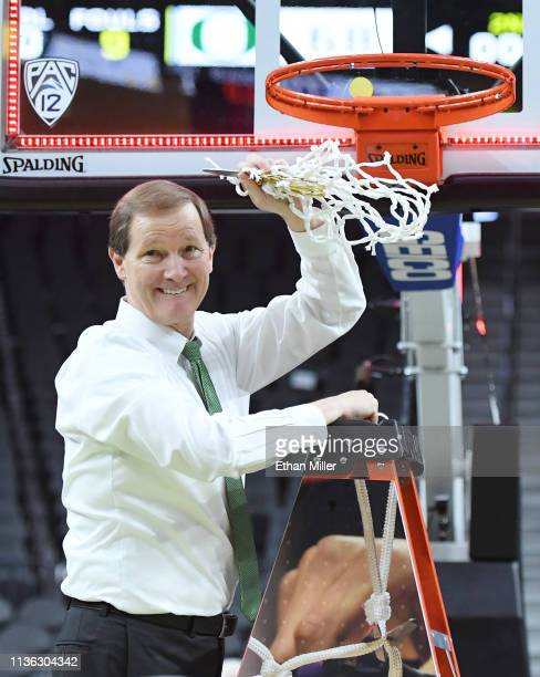 Head coach Dana Altman of the Oregon Ducks celebrates after cutting down a net following the team's 6848 victory over the Washington Huskies to win...
