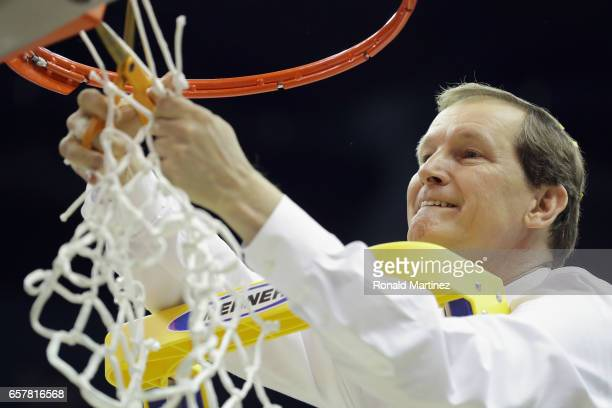 Head coach Dana Altman of the Oregon Ducks cuts the net after defeating the Kansas Jayhawks 7460 during the 2017 NCAA Men's Basketball Tournament...